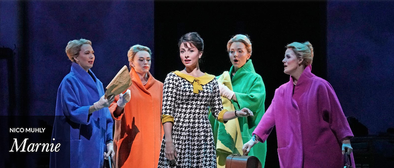 Five female characters,including Marnie, played by mezzo-soprano Isabel Leonard wearing colorful mid-century period dresses.