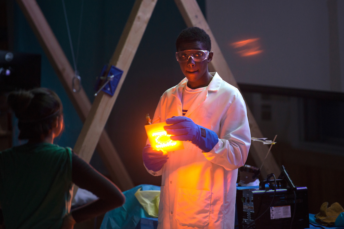 Students change the color of a light with low temperature liquid during the Material Magic Show at the UC Davis Picnic Day.