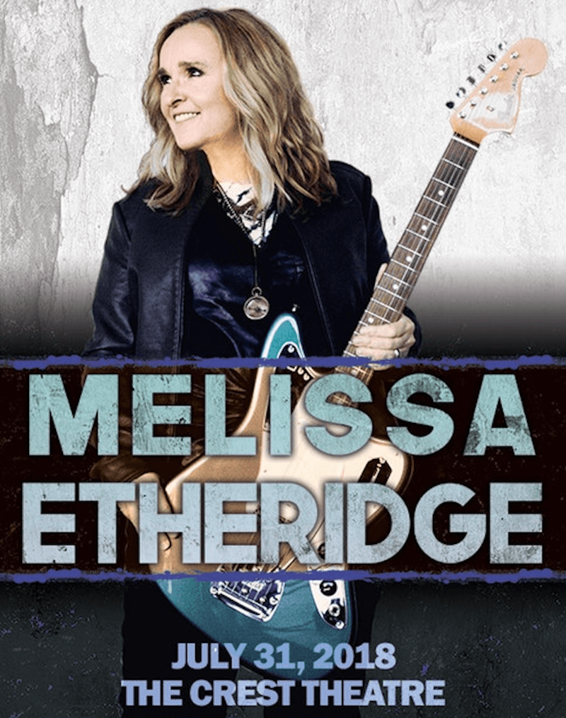 Melissa Etheridge holding an electric guitar.