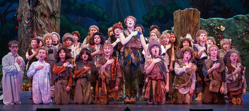 A photo of the entire cast of Peter Pan singing on stage.