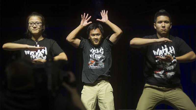 Three members of the Popping Club dancing