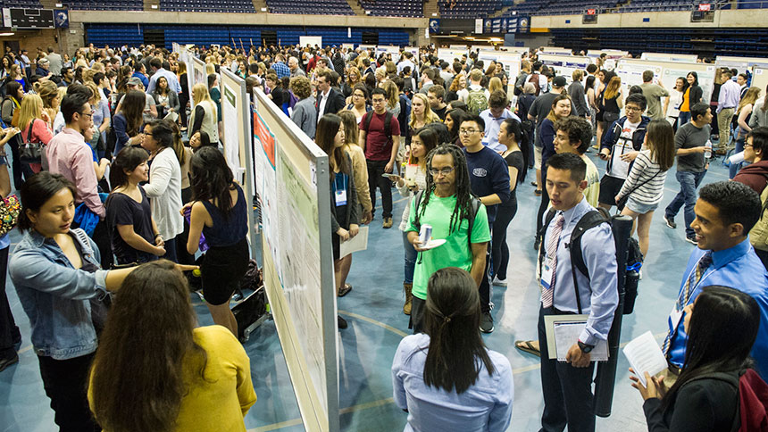 Students discuss research at poster session
