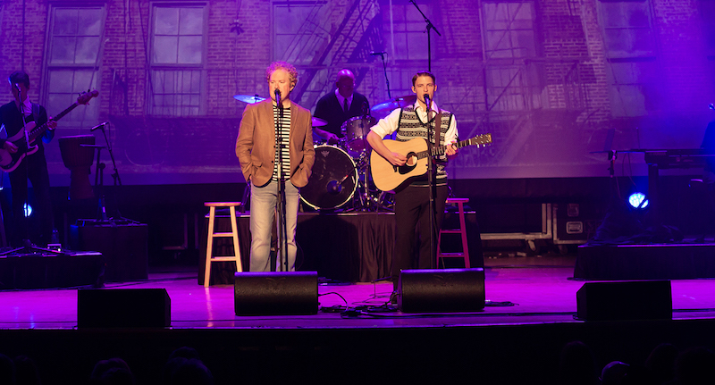A photo of the actors playing Simon and Garfunkel on stage.