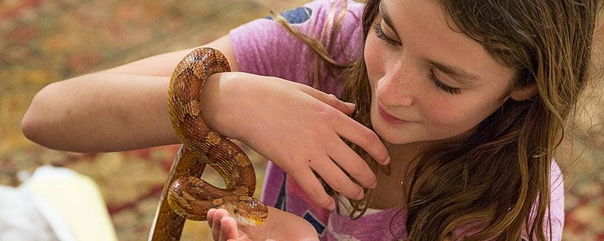 Girl handling snake