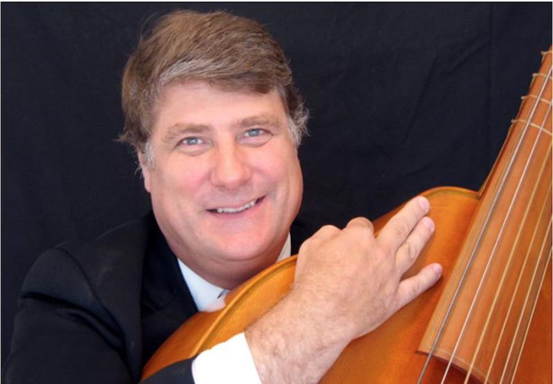 Steven Lehning holding a viola.