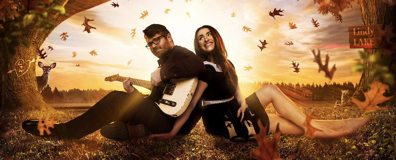 Laurel Wright and Wesley Lunsford of the Young Fables, sitting on the ground under trees with leaves falling.