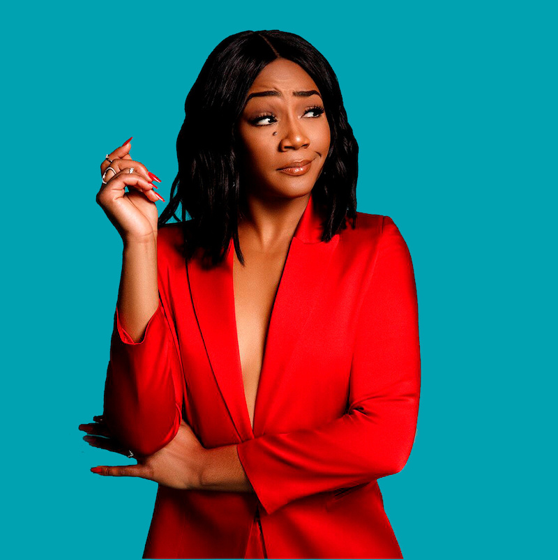 Tiffany Haddish wesring a red dress.