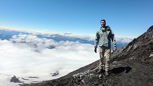 A man standing at a volcano