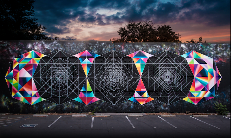 A photo of a mural displaying geometric shapes, both colorful and black-and-white.